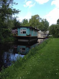 Kamer in Leiden, Rogier van Otterloopad op Kamernet.nl: Mooie woonboot met grote tuin in Leiden Zuid